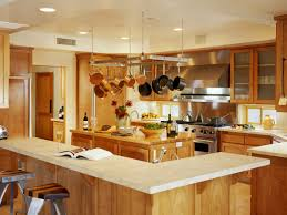 big modern kitchens white granite countertop on light brown island and cabinetry also