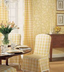 dining room with round table and yellow plaid parsons chair
