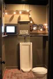 garage bathroom ideas cave bathroom my husband says a drink holder is necessary for