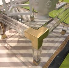 jonathan adler coffee table lucite coffee table with brass corners and feet it s all in the