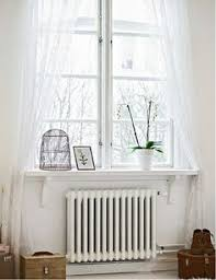 Window Sill Curtains How To Hang Curtains Over A Radiator Radiators Hang Curtains