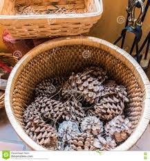 pine cones by the fireplace in a mountain hotel stock photo