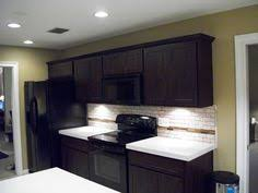 Espresso Kitchen Cabinets by Dark Cabinets White Subway Tile Back Splash Medium Toned Granite