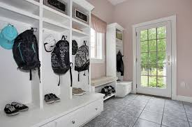 traditional mud room with built in bookshelf u0026 slate tile floors