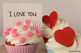heart shaped items cupcakes that is decorated with heart shaped items stock photo
