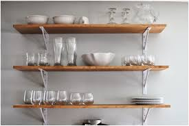 white wall mounted kitchen shelves