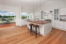 beautiful country style kitchen with timber bench tops stainless