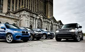2010 bmw x5 m vs 2009 jeep grand cherokee srt8 2010 land rover