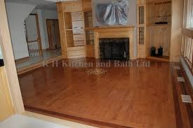 maple hardwood floor in family room with a medallion and a border