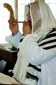 shofar tallit wearing a tallit prayer shawl his blows the