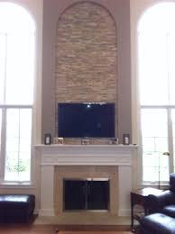 wood stove glass doors 2 story stone fireplace stone inlaid tv above fireplace custom