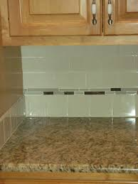 green glass subway tiles with small grey glass accent tiles