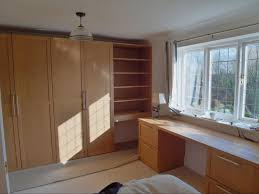 make the most of tight bedrooms with bespoke oak cabinets and