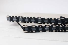 black satin ribbon ribbon laced album with black pages by blue sky papers