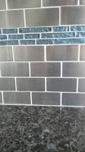 stainless tile kitchen backsplash with dark blue glass tile