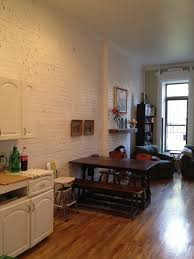 brooklyn brownstone duplex a 26 9 white painted exposed brick wall