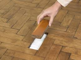 How To Fix Lifting Laminate Flooring How To Repair Parquet Flooring How Tos Diy