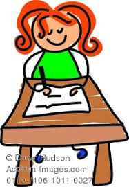image of a happy sat writing at desk