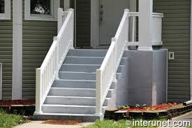 concrete porch and stairs with white balustrades interunet
