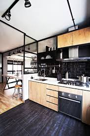 black kitchen island with sooden countertop white subway tile