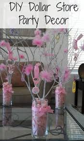 centerpieces for bautizo use mini clothespins to pin baby socks to a twig centerpiece