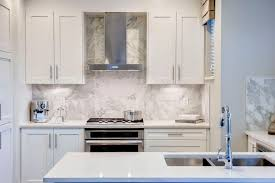 love it large scale tile backsplash