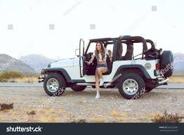 jeep jk girls young beautiful smiling on road stock photo 525525286