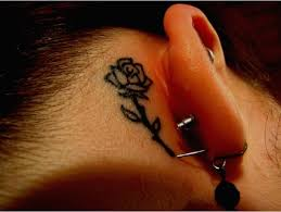 flower tattoo behind the ear this is a good spot for those who