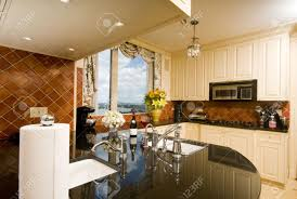 kitchen in luxury penthouse suite with skyline views of new