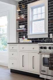 black kitchen backsplash ideas white kitchen with a black subway tile backsplash backsplashes