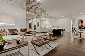 contemporary great room with white area rug by forrest gregg