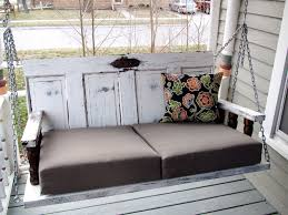 How To Make Patio Furniture Out Of Pallets by Porch Swing From Old Doors A Guy A And A Really Old House