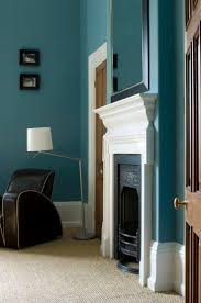 147 best paint colors i love images on pinterest paint colors a crisp white mantel is a beautiful contrasting element to the teal wall color in this traditional living room