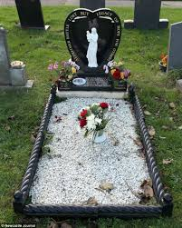 cemetery decorations widower told to remove s graveside ornamental garden by