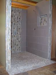 river rock bathroom ideas doorless curbless tile shower with river rock floor and mosaic