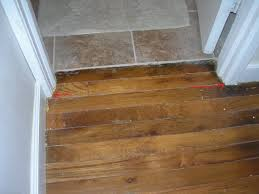 Laminate Flooring Threshold Trim Threshold Between Hardwood Floor And Tiling Into Bathroom