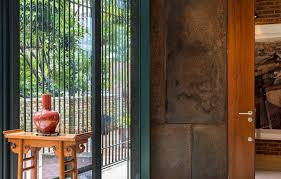 perforated screens made from reused terracotta tiles wrap around