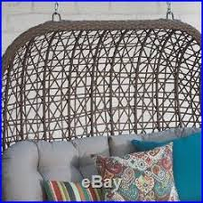brown front porch swing hanging brown wicker egg chair indoor