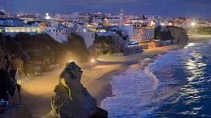beach beach beautiful rocks town lights seaside night animated
