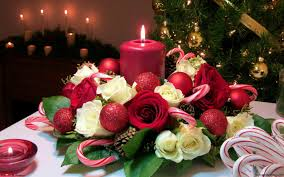 christmas candle bouquet with white and red roses red balls