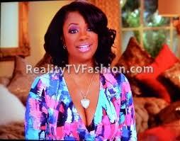 kandi burruss bob hairstyle kandi burruss orange blue print jumpsuit on real housewives of