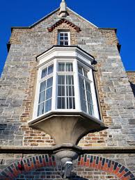 oriel window projects from the side of the building like a bay oriel window projects from the side of the building like a bay window but