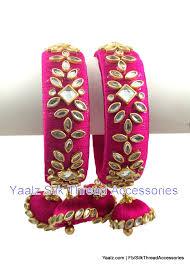rani pink colour yaalz heavy kundan stone work bangles set with hangings in rani