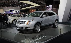 cadillac srx 4 2013 2013 cadillac srx photos and info car and driver