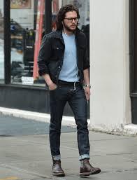 kit harington wearing black denim jacket light blue crew neck t