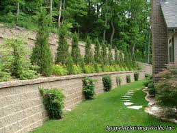 stone flooring beside low stone retaining wall ideas near green