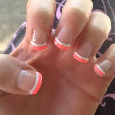 love the two toned french summer neon orange nails and orange