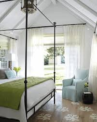 bedrooms with vaulted ceilings light gray tufted bed headboard