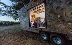 here is a tiny home with a climbing wall on its facade insidehook