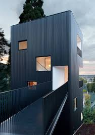 four story house with bridge entry path tower house architects
